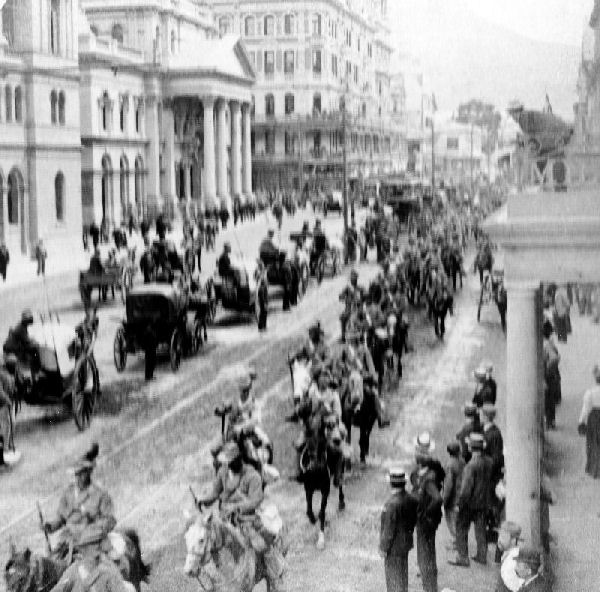 South African Light Horse coming down Alderly Street, Cape Town, to entrain for the front